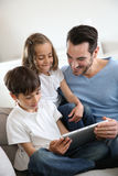 Family and electronics Stock Image