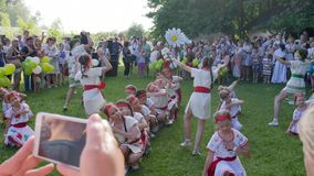 Children dance on camera at holiday ivana kupala on nature, girls dancing in costumes alfresco at festival, folk dances. Kherson, Ukraine - 8 July 2017: Festival stock footage