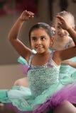 Children Dancing. Children in ballet dresses practice dance moves Stock Images