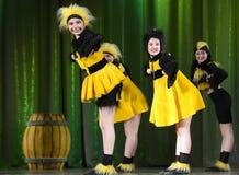 Children dancing in bee costumes Stock Photography
