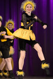 Children dancing in bee costumes Royalty Free Stock Image