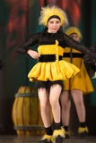 Children dancing in bee costumes Royalty Free Stock Photo