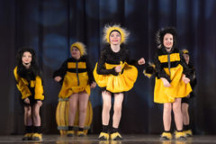 Children dancing in bee costumes Royalty Free Stock Images