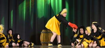 Children dancing in bee costumes Royalty Free Stock Photo