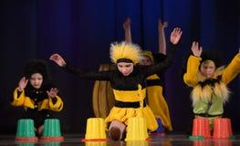 Children dancing in bee costumes Royalty Free Stock Image