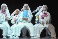 Children dancing in bunny costumes Stock Photo