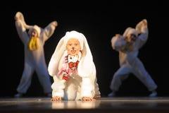 Children dancing in bunny costumes Stock Photos
