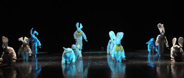 Children dancing in bunny costumes Stock Photo