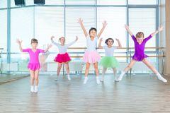 Children dancing in choreography class. happy children dancing on in hall, healthy life, kid`s togethern dance kid class. Children dancing in choreography class Royalty Free Stock Images