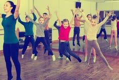 Children dancing contemp in studio smiling and having fun. Happy friendly smiling children dancing contemp in studio smiling and having fun Stock Photo