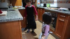 Children dancing and having fun in the kitchen stock footage