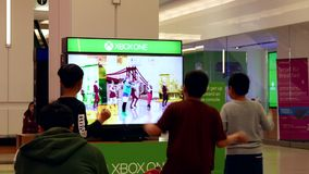 Children dancing with Microsoft demonstrated game stock video footage