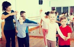 Children dancing pair dance Stock Images