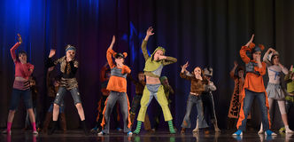 Children dancing on stage Royalty Free Stock Image