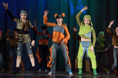 Children dancing on stage Royalty Free Stock Photo