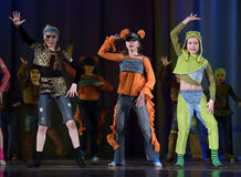 Children dancing on stage Royalty Free Stock Images