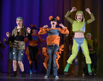 Children dancing on stage Stock Photo