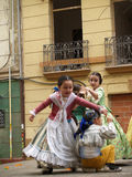 Children Dancing in the Street during the annual Celebration of Las Fallas, Valencia, Spain. File Photo:nnThe Falles (Valencian: [ˈfaʎes] ( listen), sing Stock Photos