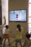 Children dancing while watching TV Royalty Free Stock Images