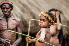Children Dani tribe learning to throw a spear. Royalty Free Stock Image
