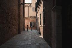 Dark Alley. Children in a dark alley in Venice Stock Images