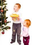 Children decorate a new-year tree Stock Photography