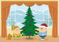 Children decorating Christmas fir tree. Children, boy, girl and dog decorating fir tree in room with view on mountains and snowy sky, Christmas holiday Royalty Free Stock Photography