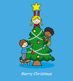 Children decorating christmas tree Stock Photography