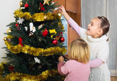 Children decorating christmas tree Royalty Free Stock Photo
