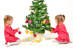 Children are decorating Christmas Tree Stock Photos