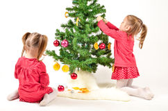 Children are decorating Christmas Tree Royalty Free Stock Photography