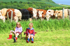 Children Deep in Conversation Outdoors Royalty Free Stock Photography