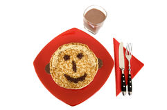 Children delight. Pancake with chocolate milk on white background Stock Photography