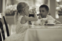 Children with dessert in cafe Royalty Free Stock Image