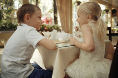 Children with dessert in cafe Royalty Free Stock Images