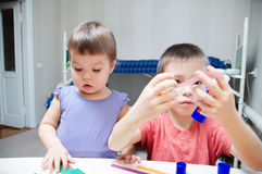 Children development - brother and sister crafting Stock Images