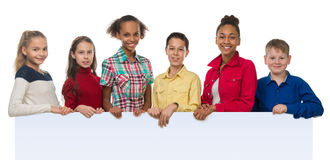 Children of different complexion holding an empty Royalty Free Stock Photo