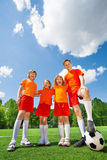 Children of different height with football in row Stock Photography