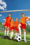 Children of different height with football Royalty Free Stock Image