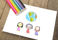 Children of different nationalities and Earth Royalty Free Stock Photos