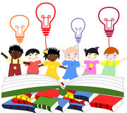 Children of different nationalities beside an open book Royalty Free Stock Photo