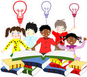Children of different nationalities beside an open book Stock Photos