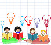 Children of different nationalities beside an open book Royalty Free Stock Photography