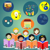 Children of different races sitting with books in their hands, Royalty Free Stock Photography