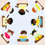 Children of different races sitting at the table and study Stock Photo