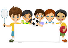 Children with different sports equipment. Group of multiracial children with different sports equipment holding a blank board woth copyspace for text Royalty Free Stock Photography