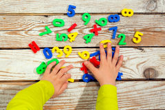 Children digits on the table. Stock Photo