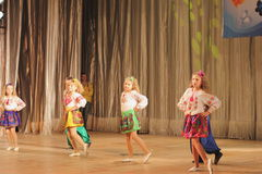 Children with disabilities dancing on stage Stock Image