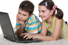 Children discovering laptop Royalty Free Stock Photo