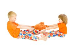 Children divide a toy. A white background royalty free stock photos